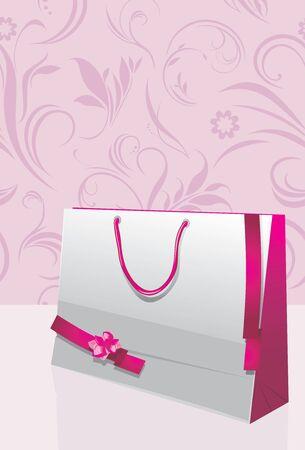 mo�os rosas: Bolsa de papel de regalo con cintas de color rosa en el fondo decorativo