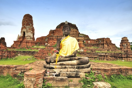 Ancient damage buddha statue in Ayutthaya, Thailand.
