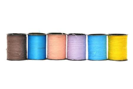 lurex: coloured bobbins thread isolated on white