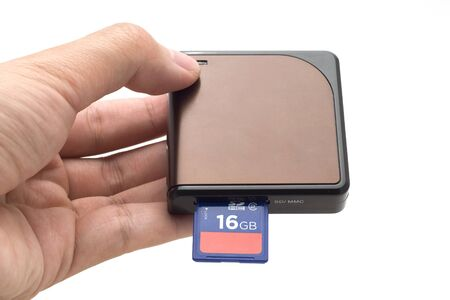 hand holding Sd card & card reader isolate on white background Stock Photo - 10960879
