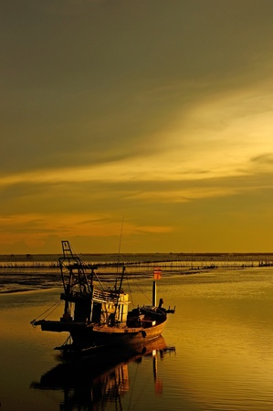 Fisherman Boat with sunset sky environment Stock Photo - 11010648