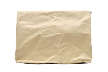 Brown crumple paper bag isolated on white photo