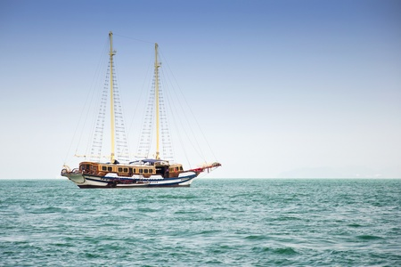 brigg: The ancient ship in the sea, Thailand Stock Photo