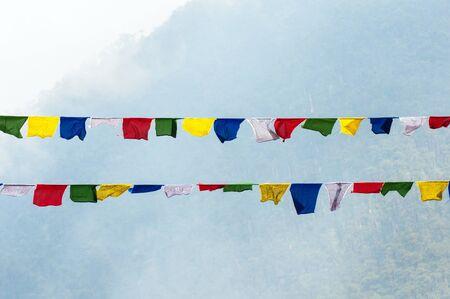 tibetan prayer flags in the mountains photo