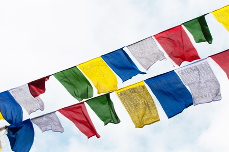 tibetan prayer flags in the mountains