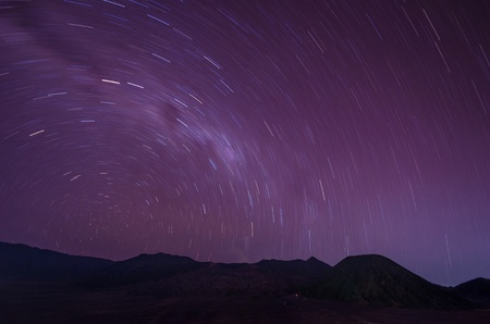 Extreme long exposure image showing star trails above the Bromo Volcano, Indonesia photo