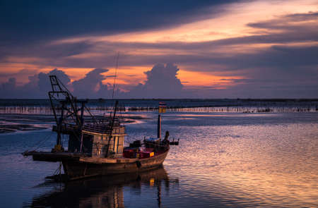 Fisherman Boat with sunset sky environment photo