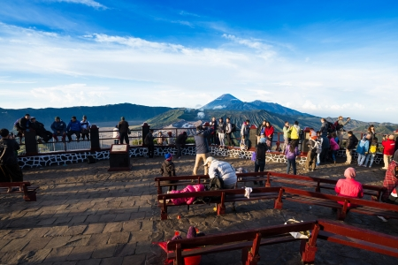 JAVA,INDONESIA-MAY 06 : Tourists at viewpoint on Mount Penanjakan,The best views from Mount Bromo to the Sand Sea below and the surrounding volcanoes are at sunrise on May 06,2013 in Java , Indonesia.