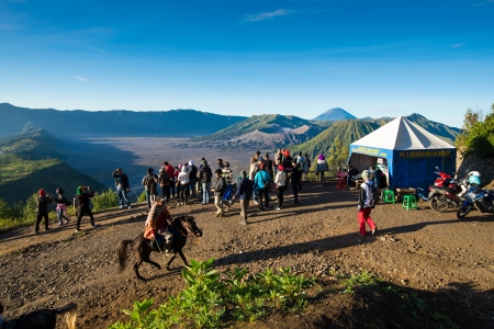 JAVA,INDONESIA-MAY 04 : Tourists hiking and ride the horse to viewpoint on Mount Penanjakan,The best views from Mount Bromo to the Sand Sea below and the surrounding volcanoes are at sunrise on May 04,2013 in Java , Indonesia.