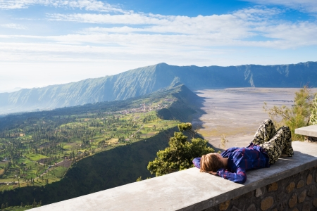 JAVA,INDONESIA-MAY 04 : Tourists at viewpoint on Mount Penanjakan,The best views from Mount Bromo to the Sand Sea below and the surrounding volcanoes are at sunrise on May 04,2013 in Java , Indonesia.