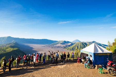 JAVA,INDONESIA-MAY 04:Tourists hiking and ride the horse to viewpoint on Mount Penanjakan,The best views from Mount Bromo and the surrounding volcanoes on May 04,2013 in Java, Indonesia.