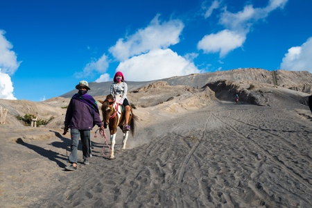 EAST JAVA,INDONESIA-MAY 05 : Tourists ride the horse at Mount Bromo, The active Mount Bromo is one of the most visited tourist attractions and part of the Tengger massif on May 05,2013 in East Java, Indonesia.