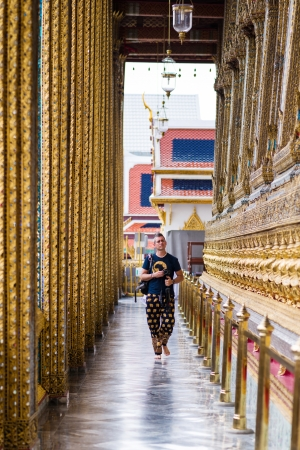 Unidentified tourists travel to Wat Phra Kaew and Grand Palace on October 22, 2012 in Bangkok, Thailand