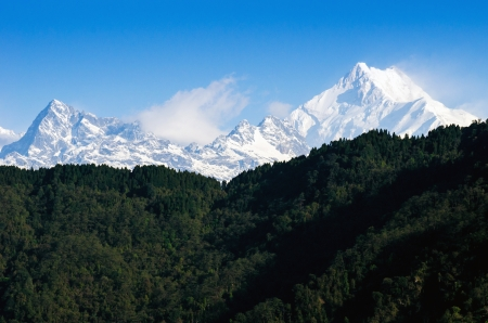 Mount Kanchenjunga range of the himalayas at Sikkim , India photo