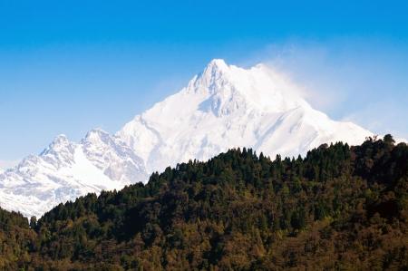 alpenglow: Kanchenjunga Mountain range of the himalayas at Sikkim , India Stock Photo