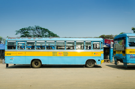 transportaion: KOLKATA, INDIA - APRIL 14:Colorful pulblic bus at Kolkata on April14, 2012 in Kolkata, India. Kolkata and its suburbs, is home to approximately 14.1 million people.