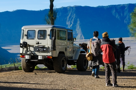 EAST JAVA,INDONESIA-MAY 05 : Tourists with Jeep at Mount Penanjakan. The best views from Mount Bromo and the surrounding volcanoes are at sunrise on May 05,2013 in East Java , Indonesia.