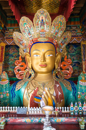 close up colorful sculpture of Maitreya buddha at Thiksey Monastery, Tibetan Buddhist monastery in Ladakh Stock Photo