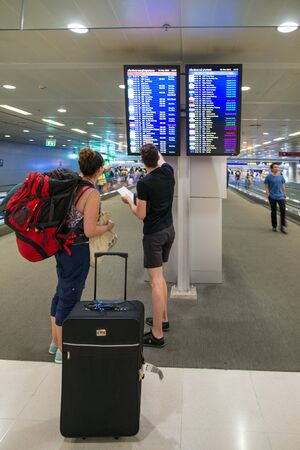 departures board: BANGKOK - MAR 01: An unidentified travellers view a departures board at Suvarnabhumi International Airport on March 01, 2015 in Bangkok, Thailand. The airport handles 45 million passengers annually. Editorial