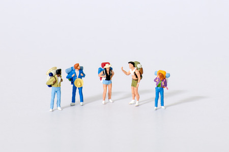 Miniature traveler figures with luggages waiting for departure at Airport Concept 에디토리얼