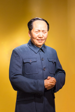 stature: BANGKOK - JUL 22: A waxwork of Chairman Mao Zedong on display at Madame Tussauds on July 22, 2015 in Bangkok, Thailand. Madame Tussauds newest branch hosts waxworks of numerous stars and celebrities.