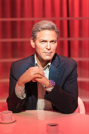 the celebrities: BANGKOK -JULY 22: A waxwork of George Clooney on display at Madame Tussauds on July 22, 2015 in Bangkok, Thailand. Madame Tussauds newest branch hosts waxworks of numerous stars and celebrities Editorial
