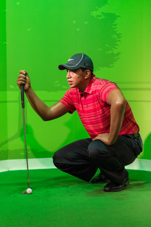 celeb: BANGKOK -JUL 22: A waxwork of Tiger Wood on display at Madame Tussauds on July 22, 2015 in Bangkok, Thailand. Madame Tussauds newest branch hosts waxworks of numerous stars and celebrities