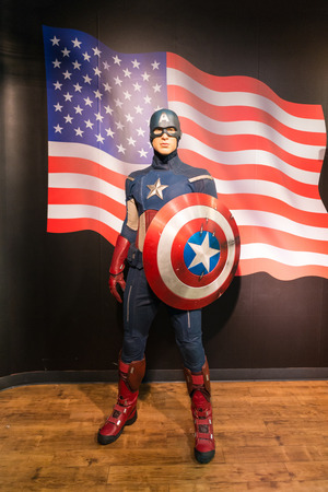 stature: BANGKOK -JULY 22: A waxwork of Captain America on display at Madame Tussauds on July 22, 2015 in Bangkok, Thailand. Madame Tussauds newest branch hosts waxworks of numerous stars and celebrities Editorial