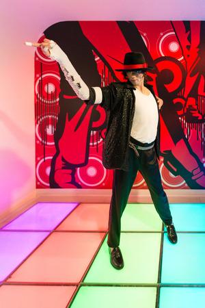 michael jackson: BANGKOK-JUL 22:: A waxwork of Michael Jackson on display at Madame Tussauds on July 22, 2015 in Bangkok, Thailand. Madame Tussauds newest branch hosts waxworks of numerous stars and celebrities