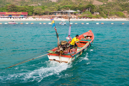 tranfer: PATTAYA, THAILAND - FEB 12: Local boat transfer at Koh Larn island on Feburary 12, 2012 in Thailand. Koh Larn island tropical beach in pattaya city receives about 5,000 tourists per day.