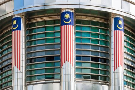 Malaysia Flag on modern building in in Kuala Lumpur,Malaysia.Malaysia is a member of Asean Economic Community (AEC) Editorial