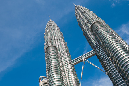 KUALA LUMPUR,MALAYSIA - JULY 11, 2009: The Petronas Towers,Petronas Twin Towers are twin skyscrapers in Kuala Lumpur, Malaysia. Malaysia.Malaysia is a member of Asean Economic Community (AEC)