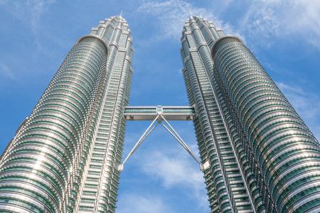 malaysia culture: KUALA LUMPUR,MALAYSIA - JULY 11, 2009: The Petronas Towers,Petronas Twin Towers are twin skyscrapers in Kuala Lumpur, Malaysia. Malaysia.Malaysia is a member of Asean Economic Community (AEC)