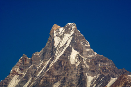 fishtail: Machapuchare or Fishtail peak with blue sky background. it is a mountain in the Annapurna Himal of north central Nepal.