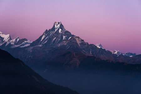 fishtail: Machapuchare or Fishtail peak with sunset sky. it is a mountain in the Annapurna Himal of north central Nepal.