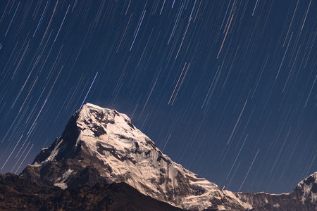 metres: Star trails over Annapurna South mountain,Nepal. Annapurna South is 7,219 metres (23,684 ft) tall.