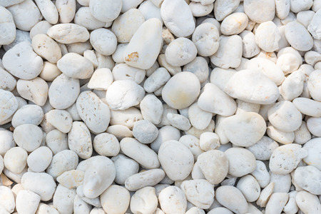 white pebble: White pebble on the small zen garden ground. Decoration material for garden