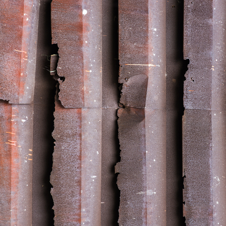 corrugated steel: Old red rusted galvanized iron plate roof background texture