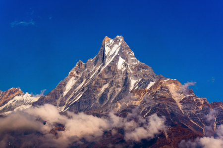 fishtail: Machapuchare or Fishtail peak with blue sky. it is a mountain in the Annapurna Himal of north central Nepal.