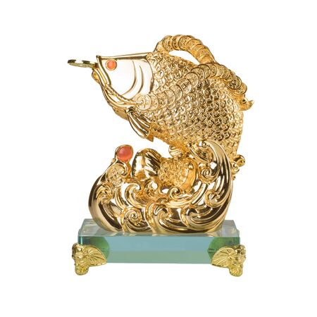 golden fish: Golden fish sculpture  isolated on the white background. Chinese decoration object for good luck meaning