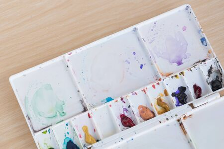 sample tray: Multi colours paint tray on wood texture background