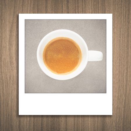 polaroid frame: Coffee cup photo in polaroid frame card on natural wood texture background Stock Photo