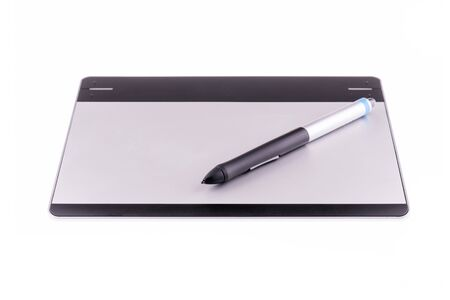 illustrators: Graphic tablet with pen and coffee cup isolated on white background. For illustrators, photographer and designers Stock Photo
