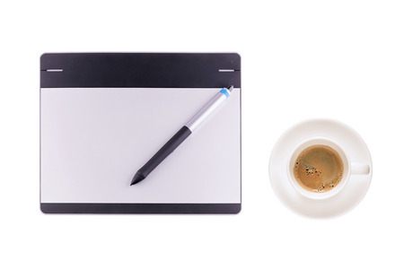 illustrators: Top view of graphic tablet with pen and coffee cup isolated on white background. For illustrators, photographer and designers Stock Photo