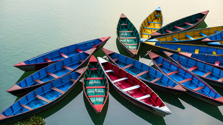 phewa: Colourful attraction Boats docked at the Phewa lake in Pokhara, Nepal.