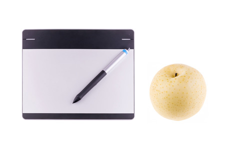 illustrators: Top view of graphic tablet with pen and chinese pear isolated on white background. For illustrators, photographer and designers