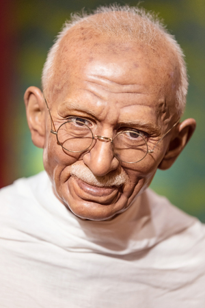 celeb: BANGKOK - JAN 29: A waxwork of Mahatma Gandhi on display at Madame Tussauds on on January 29, 2016 in Bangkok, Thailand. Madame Tussauds newest branch hosts waxworks of numerous stars and celebrities