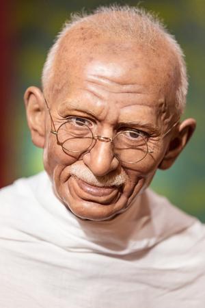 mahatma: BANGKOK - JAN 29: A waxwork of Mahatma Gandhi on display at Madame Tussauds on on January 29, 2016 in Bangkok, Thailand. Madame Tussauds newest branch hosts waxworks of numerous stars and celebrities