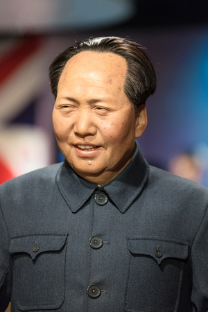 stature: BANGKOK - JAN 29: A waxwork of Mao Zedong on display at Madame Tussauds on January 29, 2016 in Bangkok, Thailand. Madame Tussauds newest branch hosts waxworks of numerous stars and celebrities.