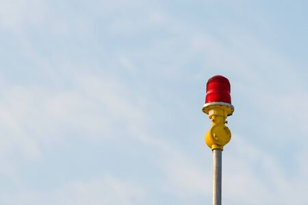warning lights: Red aircraft warning lights with blue sky background  at roof of high rise building.Elegant Design with copy-space Stock Photo